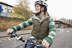 Young woman riding bicycle on street Royalty Free Stock Photos