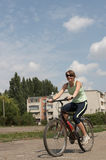 Young woman riding the bike. In the park Royalty Free Stock Photography