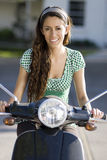 Young woman riding a bike royalty free stock photos