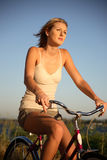 Young woman riding bike Stock Photography