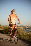 Young woman riding bike Royalty Free Stock Photography