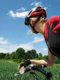 Young woman riding a bike Stock Photos