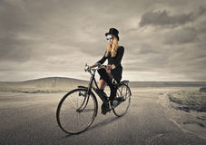 Young woman riding a bike Stock Image