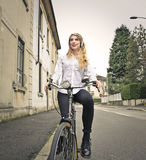 Young woman riding the bike Royalty Free Stock Images