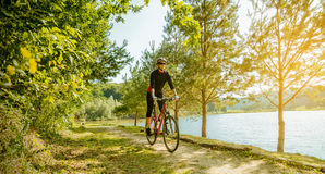 Young woman riding a bike Royalty Free Stock Images