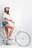 Young woman riding a bike Royalty Free Stock Photo