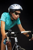 Young woman riding bike Royalty Free Stock Photos