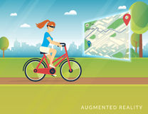 Young woman riding a bike and seeing bicycle path on the mobile augmented reality map Royalty Free Stock Photo