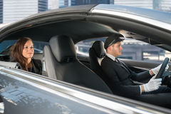 Young Woman Riding In A Car With Chauffeur Stock Photos