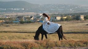 Young woman riding horse on meadow. stock video