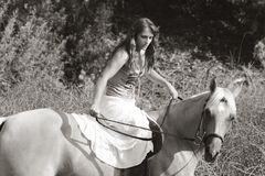 Young woman riding on horse (motion blur) Stock Image
