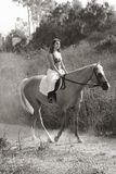 Young woman riding on horse (motion blur) Stock Images