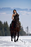Young woman riding horse outdoor in winter Royalty Free Stock Images
