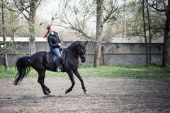 Young Woman Riding Horse Royalty Free Stock Images