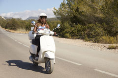 Young Woman Riding Motor Scooter On Country Road Stock Photos