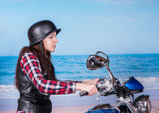 Young Woman Riding Motorcycle on Beach Royalty Free Stock Photography