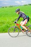 Young woman riding a mountain bike Royalty Free Stock Image