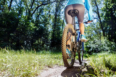 Young woman riding mountain bike Stock Photos