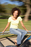 Young Woman Riding On Roundabout In Park Royalty Free Stock Images
