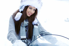 Young woman riding a snowmobile Royalty Free Stock Photography