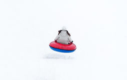Young woman riding on the tubing. Inflatable sledges. Stock Images