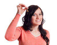 Young woman ringing the bell Stock Photo