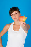 Young woman with ripe apple Royalty Free Stock Image