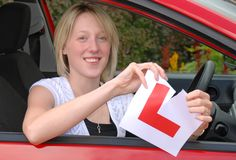 Young woman ripping L Plate Stock Photo