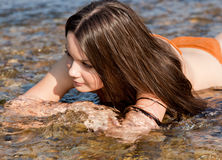 Young woman on a river Stock Image