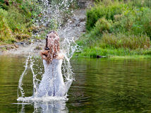 Young woman in a river Stock Photos