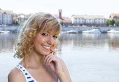 Young woman on a river laughing at camera Stock Photo