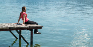 Young woman on river shore Stock Image