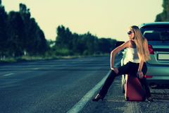 Young woman on the road Royalty Free Stock Images