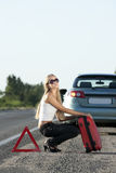 Young woman on the road Stock Image
