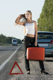 Young woman on the road Royalty Free Stock Photos