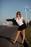 Young woman on the road Royalty Free Stock Photo