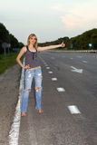 Young woman on the roadside Stock Photo