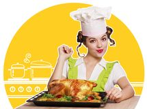 Young woman and roasted chicken in the kitchen Stock Photography