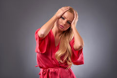 Young woman in a robe Royalty Free Stock Photography