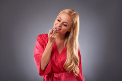 Young woman in a robe Royalty Free Stock Image