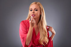 Young woman in a robe Stock Photos