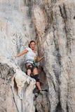 Young woman rock climbing on white mountain Royalty Free Stock Photos