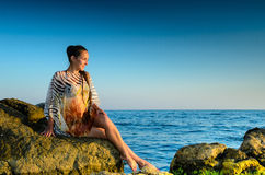 Young woman  on a rock Royalty Free Stock Photos
