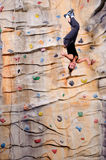 Young woman on rock wall Stock Photos