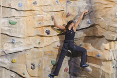 Young woman on rock wall Royalty Free Stock Photography