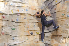 Young woman on rock wall Royalty Free Stock Image