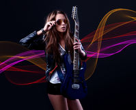 Young  woman rockstar with blue electric guitar Royalty Free Stock Photography