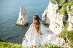 Young woman on the rocky coastline Stock Images