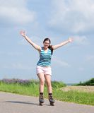 Young woman on roller blades Royalty Free Stock Images