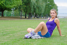 Young woman on roller skates. Stock Photo